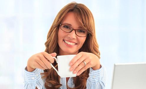 Office worker drinking coffee